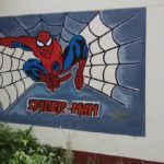 An outside wall covered with Spiderman