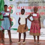 Junior girls parade their best clothes