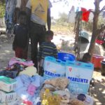 The family of 7 receives basic food and supplies from MRCH
